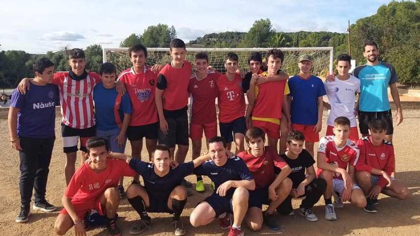 Partit de futbol d'ESO amb la participació de los jugadors de Nàstic Genuine